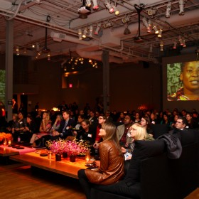The audience at the 2010 Investor Gathering watches a video on what dignity means to our entrepreneurs.