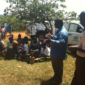 2010 Acumen Fund Fellow, Josephat Byaruhanga, conducting a community training in the field with Western Seed Company