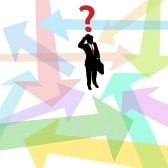 9616790-business-person-standing-in-confusing-arrows-makes-decision-to-answer-question
