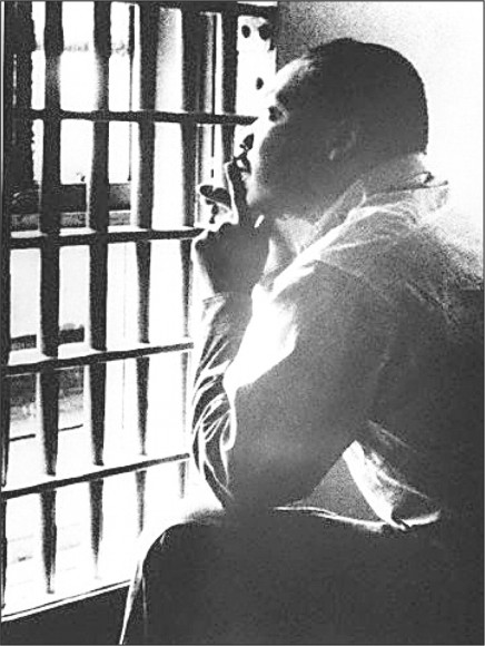 Martin Luther King Jr. sits in a jail cell at the Jefferson County Courthouse in Birmingham, Alabama