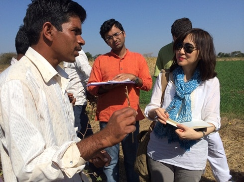 Vikki (right) and Urmil, an AC from Mumbai (center) interview a smallholder farmer (left)
