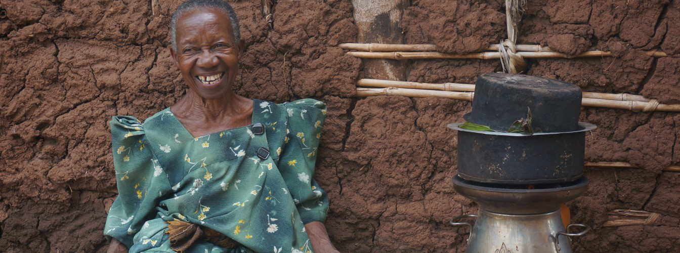 Grandmother_With_HomeStove_ToChargePhone_Uganda