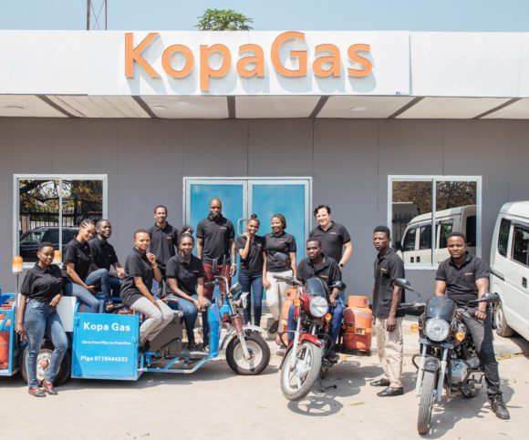 The KopaGas team stands outside their office in Dar es Salaam, Tanzania.